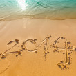 New Year 2014 written in sand on the beach — Stock Photo #56147687