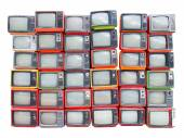Many old vintage televisions pile up isolated on white backgroun — Stock Photo