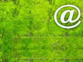 Email sign or att sign on green moss plant background — Stock Photo
