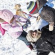 Family playing in snow. — Stock Photo #61399651