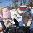 Family playing in snow. — Stock Photo #61399655
