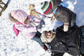 Family playing in snow. — Stock Photo