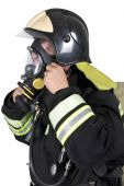 Firefighter corrects overview mask breathing apparatus — Stock Photo