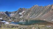 Beautiful lake at the foot of the mountain range — Stock Photo