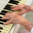 Senior woman Pays Piano — Stock Photo #53772989