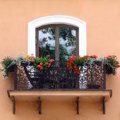 Classic balcony with flowers — Stock Photo
