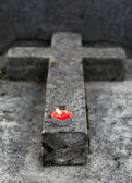 Tombstone with burning candle — Stock Photo