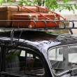 Vintage suitcases on the car roof — Stock Photo #61298971