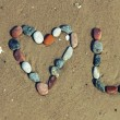 Love words written on the beach — Stock Photo #78294610