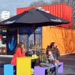 Постер, плакат: Family in Spring at the Restart Container Shops in Christchurch