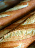 Detailed View of Fresh Baked French Loaves for Sale. — Stock Photo