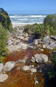 Rocks on Scotts Beach at the start of the Heaphy Track on the We — Stock Photo