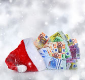 Euro banknotes coming out of Santa Claus hat — Stock Photo