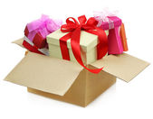 Gifts in a Cardboard box on white background — Stock Photo
