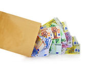 Euro banknotes coming out of a paper bag on white background — Stock Photo