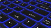Laptop black keyboard with blue light background — Stock Photo