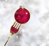 Golden fork with Christmas ball in a glittery background — Stock Photo
