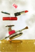 Various cosmetics in a glittery background — Stock Photo