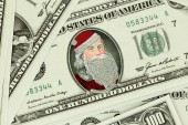 Bank notes with Santa Claus portrait background — Stock Photo