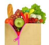 Unzipped shopping bag filled with groceries — Stock Photo