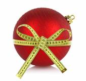 Christmas ball with measuring tape isolated on white — ストック写真