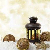 Christmas lantern and ornaments on snow — Stock Photo