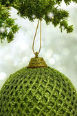 Christmas green ball hanging from a branch — Stockfoto