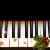 Christmas branch on piano keys — Stock Photo