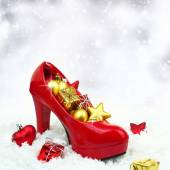 High heel shoe with christmas ornaments on snow — Stock Photo