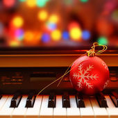 Christmas ball on piano keys — Stock Photo