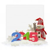 Snowman and new year 2015 in front of a paper card  — Stock Photo