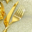 Christmas golden cutlery and ornaments on festive background — Stock Photo #58375567