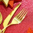 Christmas golden cutlery and ornaments on festive background — Stock Photo #58375569