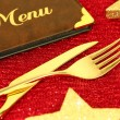 Christmas golden cutlery and restaurant menu on festive background — Stock Photo #58375769