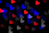 Defocused heart bokeh lights, abstract background — Stock Photo