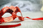 Vintage carnival mask in front of glittering background — Stock Photo