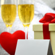 Card with two glasses of champagne, gift box and heart — Stock Photo #61703253