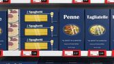Various 3D pasta boxes on supermarket shelve — Stock Photo
