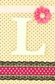 Wooden letter L on polka dots background — Stock Photo