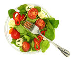 A bowl of fresh colorful salad and a fork isolated — Stock Photo