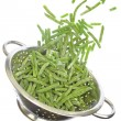 Colander with frozen green beans isolated on white — Stock Photo #65965007