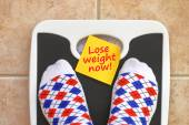 Woman's feet on bathroom scale. Diet concept — Stock Photo