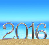 New year number 2016 on the beach — Stock Photo