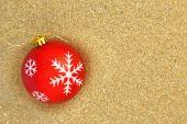 Christmas ball on the beach — Stock Photo