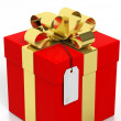 Red gift box with golden ribbon and blank tag isolated on white — Stock Photo #77849884
