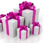 Geschenk-Boxen mit rosa Bändern in verschiedenen Größen, die isoliert auf weißem Hintergrund — Stockfoto #77850052