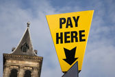 Yellow Pay Here Sign — Stock Photo