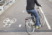Cyclists on Bike Lane in Amsterdam, Holland — Stock Photo