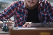 Hipster man working in cafe — Stock Photo