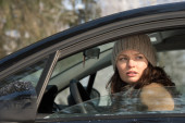 Woman driving car in winter — Stock Photo